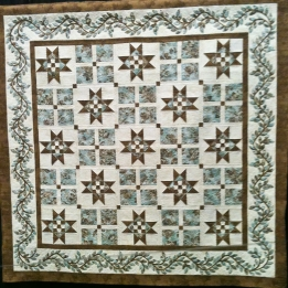 A beautiful traditional quilt in chocolate and teal.